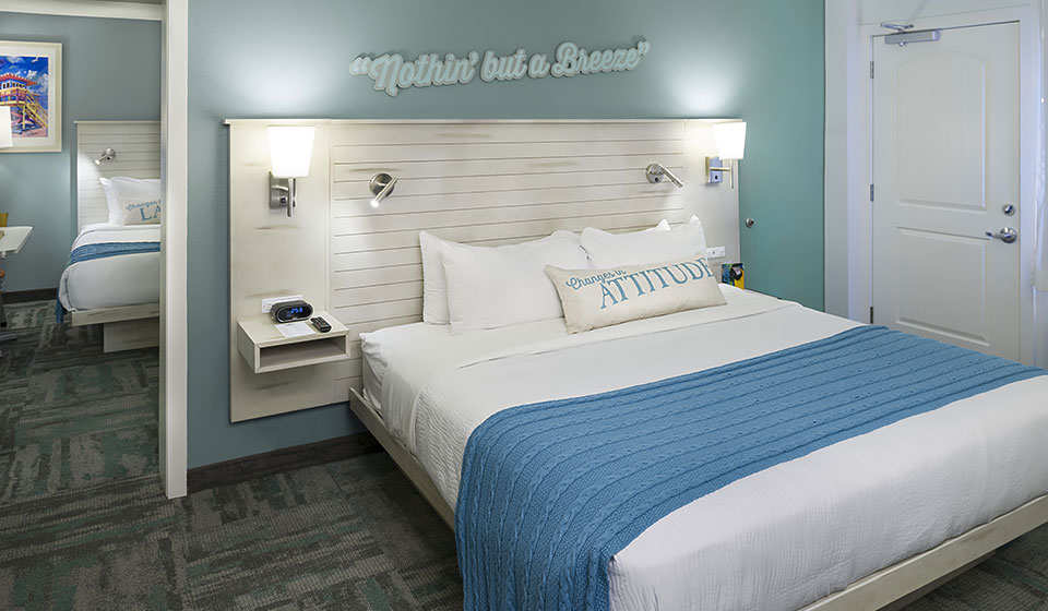 family suite rooms with two spacious rooms, colorful bedding, shiplap headboards and island-themed artwork