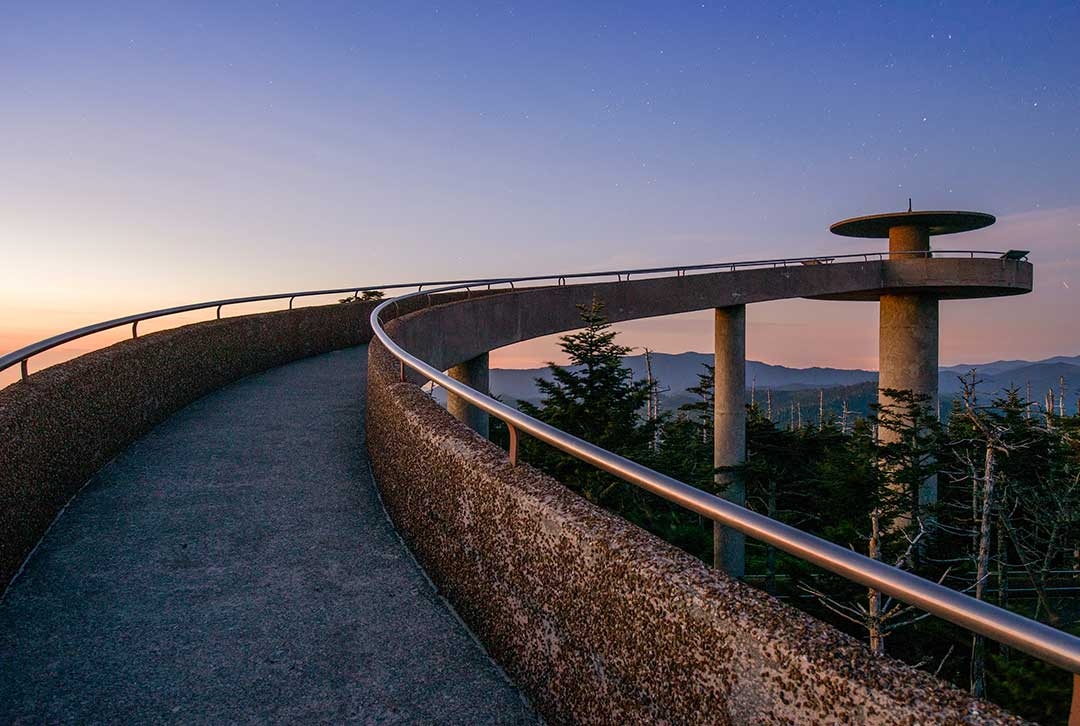 Image of a concrete walkway overlooking the valley below