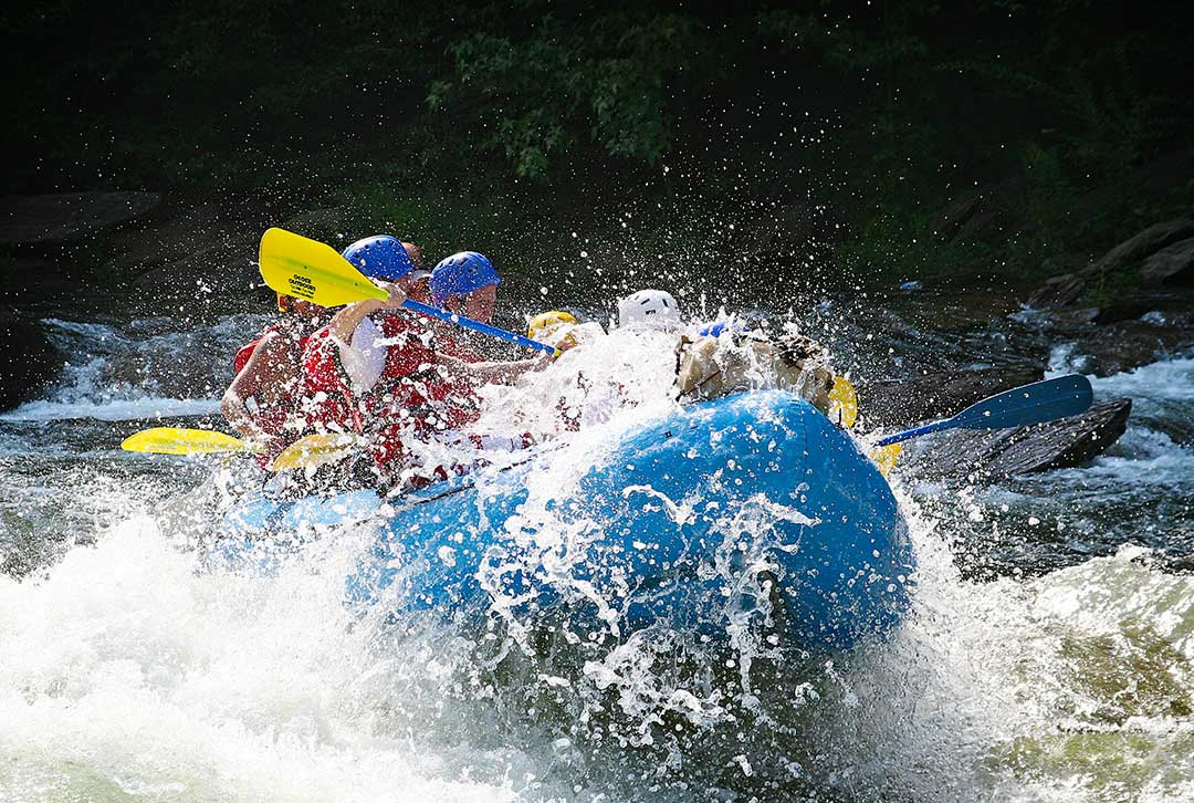 Group of outdoor enthusiasts enjoy a whitewater rafter adventure