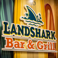 The landshark bar and grill logo on the wall
