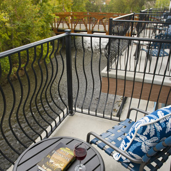 Balcony with chair and table overlooking the river
