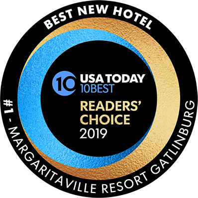 Voted USA Today Readers' Choice 2019 Best New Hotel Circular image with black border, white text overlay and colorful blue and gold swirled foil textures surrounding the Reader's Choice announcement