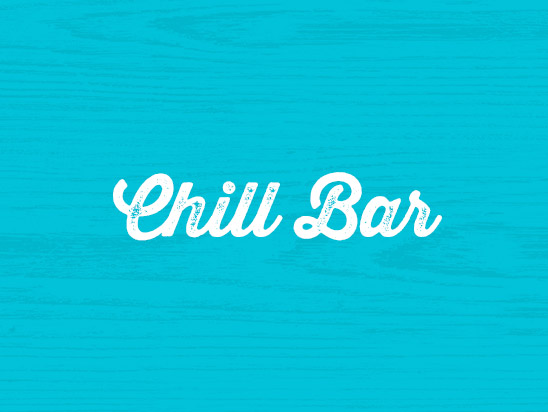 THE CHILL BAR interior with wooden chairs and table