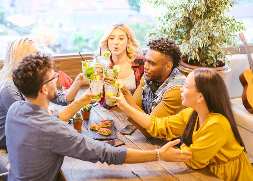 Group of people having drinks - cheers