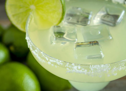 Margarita rimmed with salt garnished with lime
