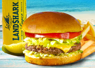 Cheeseburger and fries and a LandShark beer in a glass
