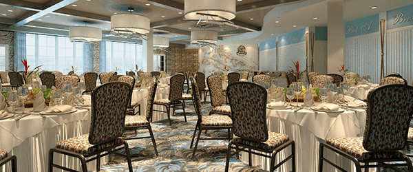 Large banquet room with tables with white tablecloths and chairs