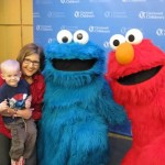 Elmo and Cookie Monster Make It A Sunny Day At Seacrest Studios