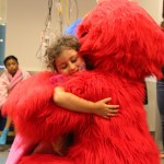 Elmo And Grover Dance With Patients At Seacrest Studios