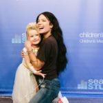 Halsey makes friends with a princess in Seacrest Studios Dallas