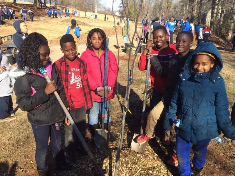 WINGS kids Planting Trees at the Original Gravesite of Dr. King