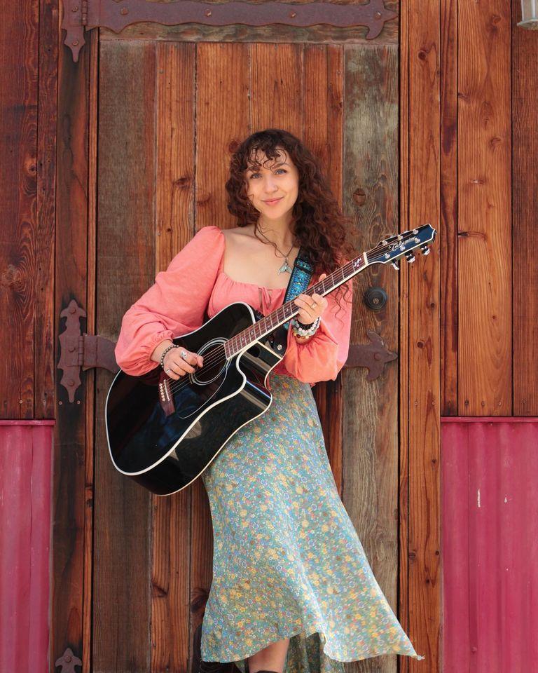 Calista Garcia holding a Takamine Guitar
