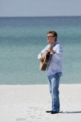 Todd looks great playing his guitar on the beach!