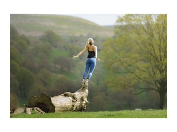 Wall_woman_gracefully_falling___jumping_of_tree_in_field-2