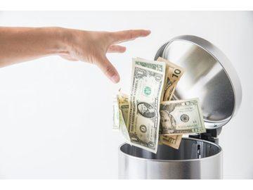 Wall_throwing_away_money