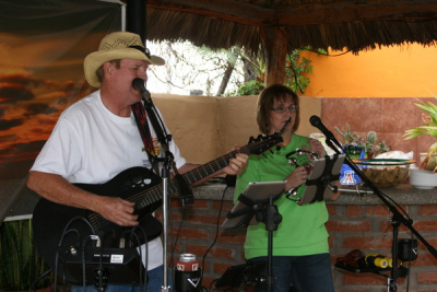 My wife Gay and I with the band at a Happy Hour at the Pool Totonaka RV resort San Carlos