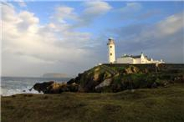 The lighthouse is the Fanad Head Lighthouse, Co. Donegal.  Absolutely stunning location on the northern tip of the point.  Lighthouse has been operating since the 1800's!  The day that I was in this area was very grey and cloudy.  Within moments of arrivi