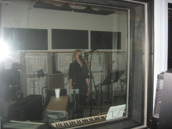 <p>&nbsp;KC recording vocal tracks</p>