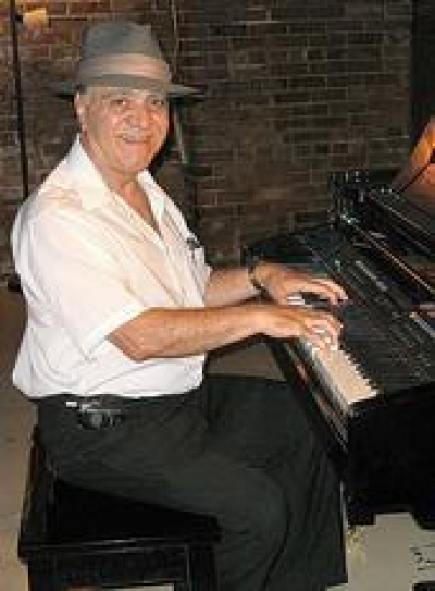 Johnny Ferrara is the closest thing to Oscar Peterson I have ever heard in public.  The man is an amazing pianist who has played in the presence of many a distinguished professional entertainer including Bob Hope and several U.S. Presidents.  He is a reti