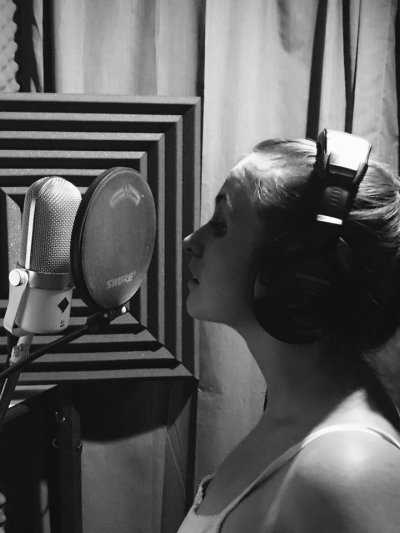 Dayna doing a harmony vocal in the studio