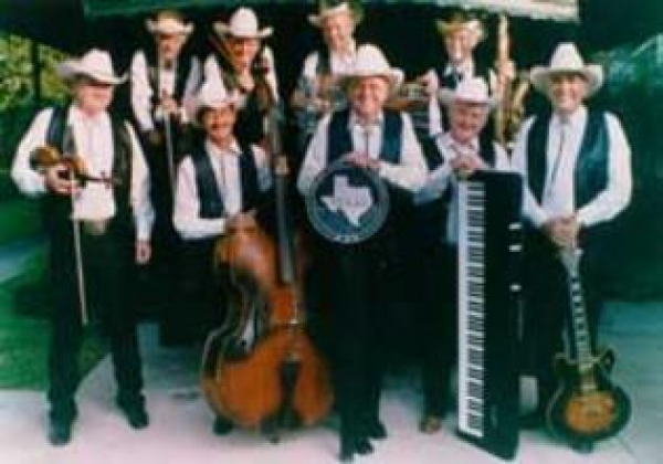 Leon Rausch and the TEXAS PLAYBOYS!  We had the pleasure to be an opening band for this historic and wonderful musical group in September 08.  Bob Wills would be PROUD of these guys!  Wayne=o sings