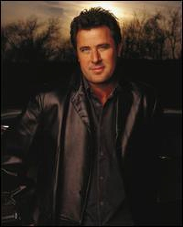 Vince Gill....an OKIE with a TEXAS soul!  Man, this guy has it ALL!  Plays his Fender Telecaster at Master Elite level, writes unbelievably well, and sings in that tenor voice some of the most moving balads you will ever hear!  Plus, Vince has a great sen