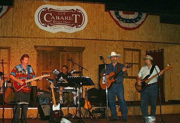 LOOKIN BACK!!!  The LONE STAR PICKERZ shot in 2004 at the historic CABERET DANCE HALL. This venue and stage has hosted the who's who of COUNTRY music since 1936 in Bandera TX, COWBOY CAPITOL OF THE WORLD!  Pictured are LSP Band Alumni Tooter Ripps on Bass