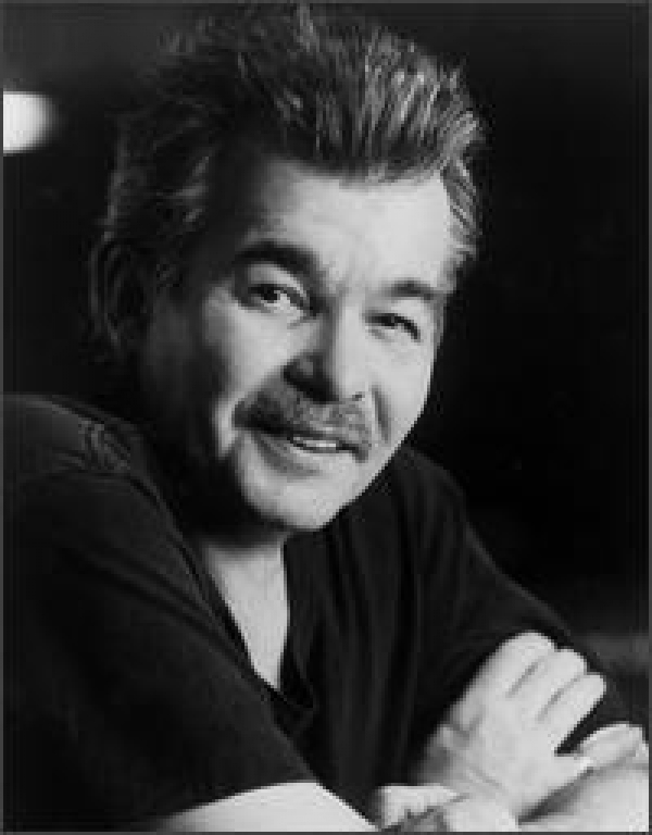 John Prine...His vocals are definately unique, and John is one of the most brilliant songwriters ever...many have covered his songs including George Strait's