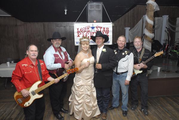 BIG FUN WEDDING in FALL 2009...cowboy style! Angie looks great, huh!