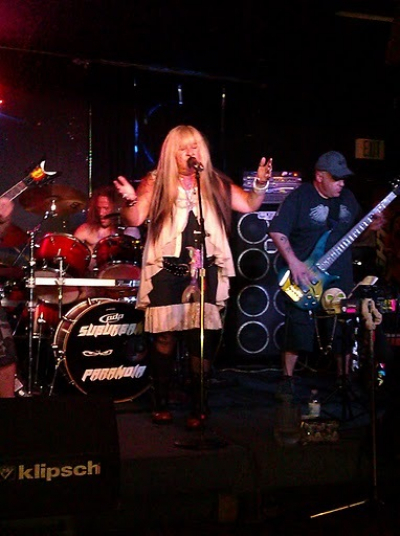 Scarlett singing with the thrash metal band