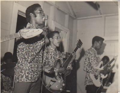Group Solo Guyana.. Mickey D,Mike Bernard, Tarudy Mcgarell drummer  behind drums, Reg