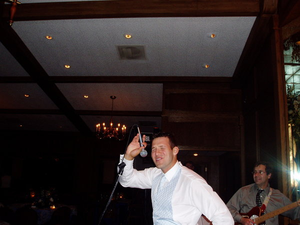 <p>Take a close look, this is a pretty darn good QB in the NFL right now, and yep, he was once a best man, and lead singer with MOOT, ( he probably doesn't remember this moment )</p>