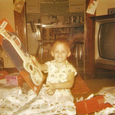 Little Mark Francis at age 4 getting his first guitar for Christmas. Who would have thought it to be such a defining moment