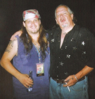 Mark Francis and former Molly Hatchet singer Jimmy Farrar about to steal the security guy's golf cart and terrorize the campground