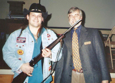 Mark Francis and author Loren Coleman with the late Texas Billionaire/Explorer Tom Slick's rifle