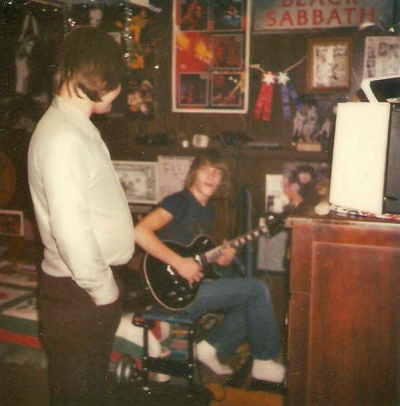 Circa 1979, Uncle Stan watches as Mark jams on his new black Les Paul