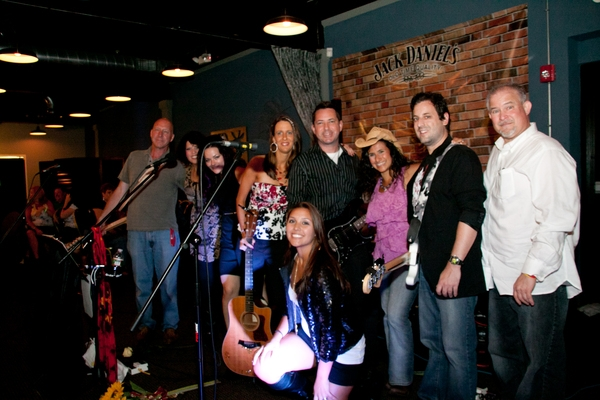 The band: Gary Jakubicki (lead guitar), Jo Wymer(harmonica, shaker eggs), Kelly Carvin(background), me, Paul Myatovich(guitar), Marisha Jakubicki(kneeling-background), Sandy Zio(background and MC), Mike Thompson(bass) and Danny Coleman(drums).  My beautif