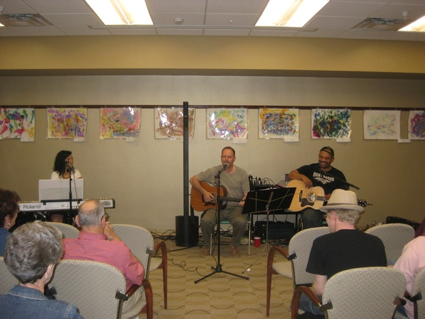 Sandy Zio looks on as Joe Iantosca,our guest songwriter shares a song.