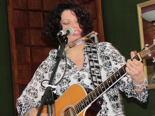 Wymer plays, sings, harmonicas, she does it all!