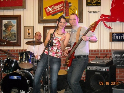 "<p>Ashley ""The Blue Note Babe"" On stage with her Fiance' Keeping the boys on track with her tamborine !  </p>"