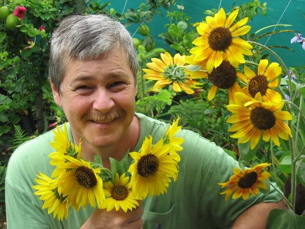 Posing with posies in the backyard, October, 2009, Aloha Aina, Hawai'i