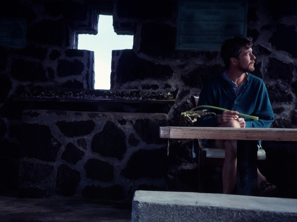 This picture was taken in 1999 in the chapel of a small Hawai'ian church in Punalu'u on the southern coast of the Big Island of Hawai'i. (Self portrait using camera timer.) It was inspiring to be in a grace space, and the light was right!   (I am holding