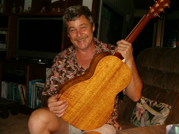 Arthur with his new mail order bride - a koa parlor guitar with wood from the Big Island, made by Larrivee, then sent back to Hawai'i. Needless to say I am delighted with my new friend. (2008)