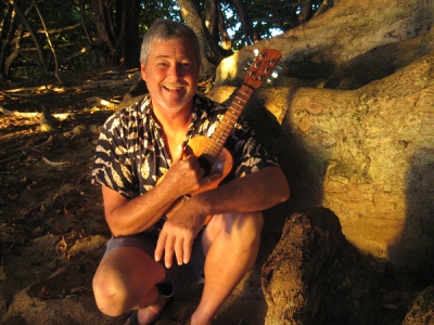 July, 2013 at the beach on Hanalei Bay, Kauai, Hawai'i, hanging under the Kamani trees that line the shore, after gigging poolside at the Saint Regis Princeville Resort. A busker at the palace, no doubt. Lovely. The sunset light for this picture was nice.