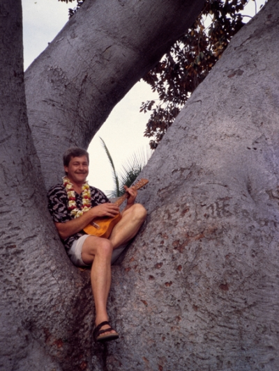 Hambone in a tree playing ukulele, Kailua-Kona town, Big Island, Hawai'i. (2001)
