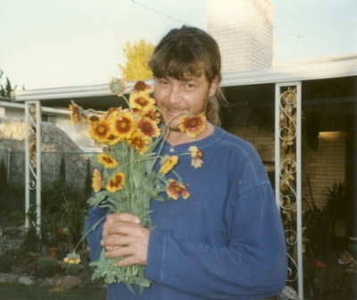 Posing with Posies in the backyard of 2613 Crestview Dr., cerca 1994, Las Cruces, NM (Flowers are Gaillardias)