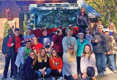 The holiday gathering at Hilton Head Fire Station 3 was a joint effort of Project Unify, Hilton Head Fire Rescue and Pockets Full of Sunshine. Brooke Simons and Alexis Olivolo are on the front row, second and third, respectively, from left. SUBMITTED