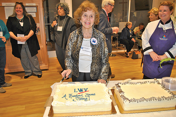 Fran Robertson was celebrated as a 50-year member of the League of Women Voters at the organization's Feb. 10 reception. She was honored with the duties of cutting the celebratory cake. GWYNETH J. SAUNDERS