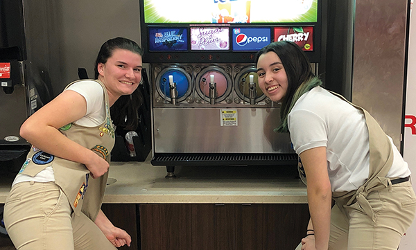 Tatum Springer and Bailey Sullivan goof around a soda machine after school. The young women are among just six Girl Scouts of Eastern South Carolina to be selected as Honorary Legislative Pages for the state legislature. COURTESY GIRL SCOUTS OF SOUTHERN B