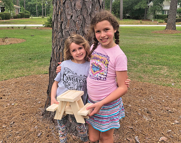 During family isolation due to COVID-19, Myra and Marina Onofrio helped their dad build squirrel-sized picnic tables to sell as a fundraiser for Palmetto Animal League. KEVIN ONOFRIO
